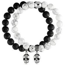 Stretch Bead Bracelet With Silver Tone Skull